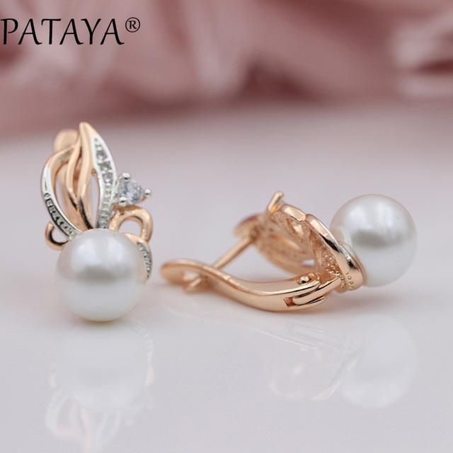 Pendientes tipo llama de oro con gota de perla