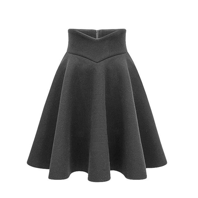 59e07fc0f Tres Colores de lana Falda plisada color sólido del invierno de las mujeres  delgada cintura alta una línea de Faldas temperamento de moda más el ...