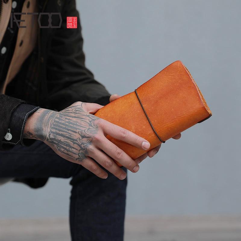 AETOO Retro prendere la mano del raccoglitore lungo di cuoio di grande capienza gioventù testa strato di pelle bovina borsa a mano-in Portafogli da Valigie e borse su  Gruppo 1