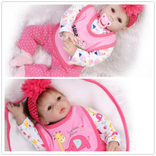 Retail Good Price 55cm 22inch Reborn-Baby-Doll With Lovely Baby Doll Clothes And Flower Hair Band Happy Christmas Bebe Brinquedo