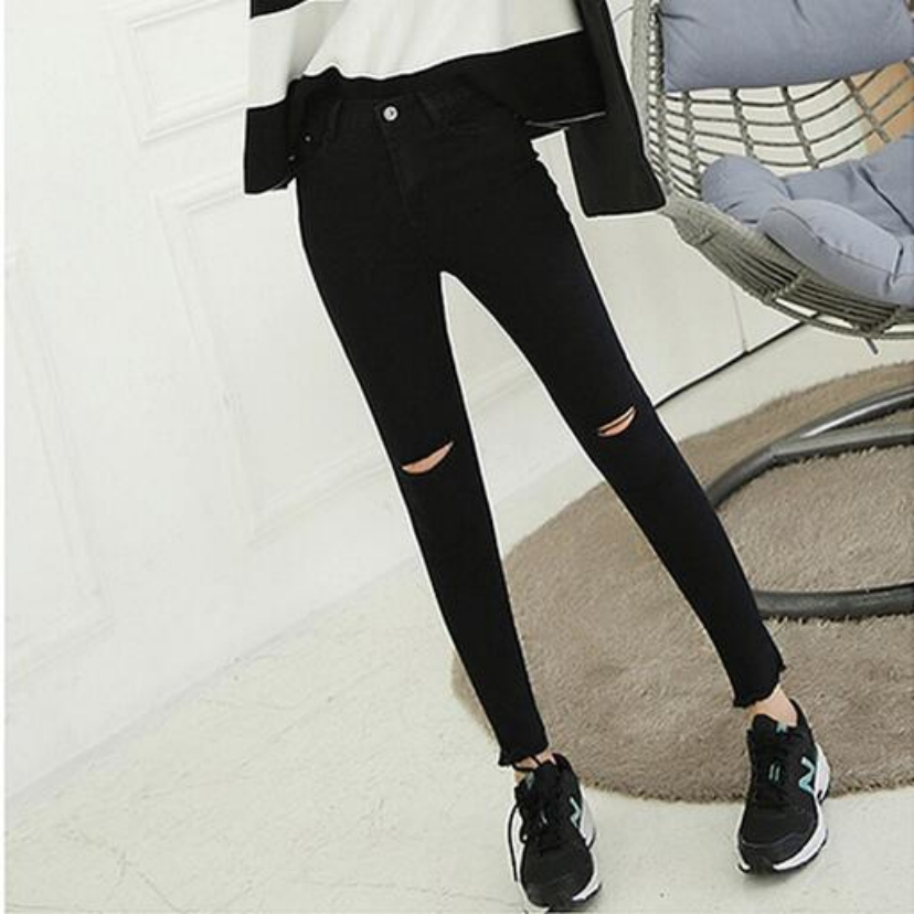 The new knee female nine points black hole hole jeans beggar pants stretch feet pencil pants