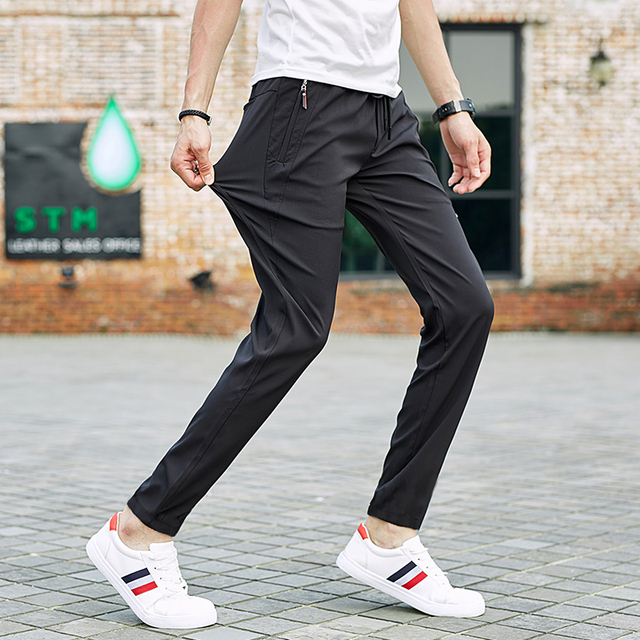 2406a796e31f SeaSunLand Waterproof Quick Dry Pants Outwear Fashion Mens Harem Pants High  Quality Elastic Trousers Casual Active Jogger Pants
