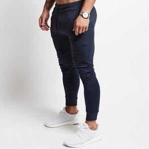 Image 4 - Pantalons de Jogging rouge hommes rayé Sport pantalons de survêtement pantalons de course pantalons de gymnastique hommes coton survêtement Fitness survêtement pantalon de musculation