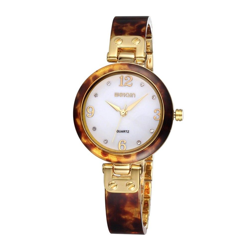 Новый розовое золото часы Для женщин смолы Группа Shell циферблате кварцевые наручные часы роскошные женские часы Агат Янтарная полоса