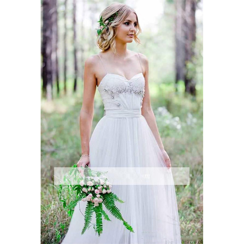 Beach Wedding Dresses Spaghetti Straps Pure White Ruched Tulle 2017 Beaded  Crystal Wedding Dress Simple Style Fairy Bridal Gowns-in Wedding Dresses  from ... c0d158bc62e1