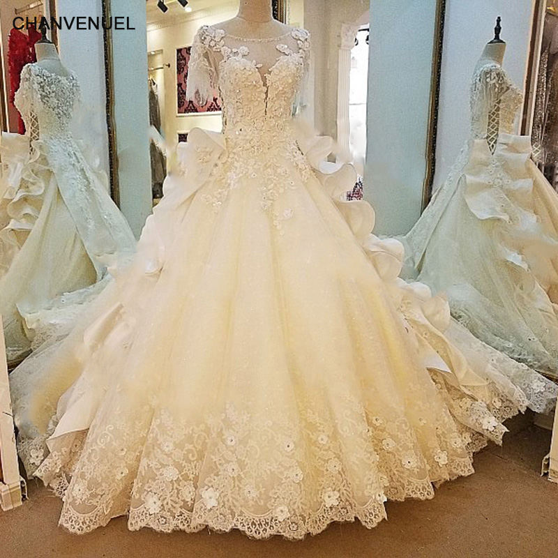 Ivory Lace Bodice Ball Gown Wedding Dress With Sheer Long: LS65789 Lace Wedding Gown Short Sleeves Corset Back