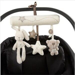 Image 1 - погремушки игрушки для коляски Детская плюшевая погремушка, игрушки на коляску, подвесная кровать, коляска кроватка, Мягкая Милая Музыкальная погремушка с кроликом, развивающие , кровать для новорожденных