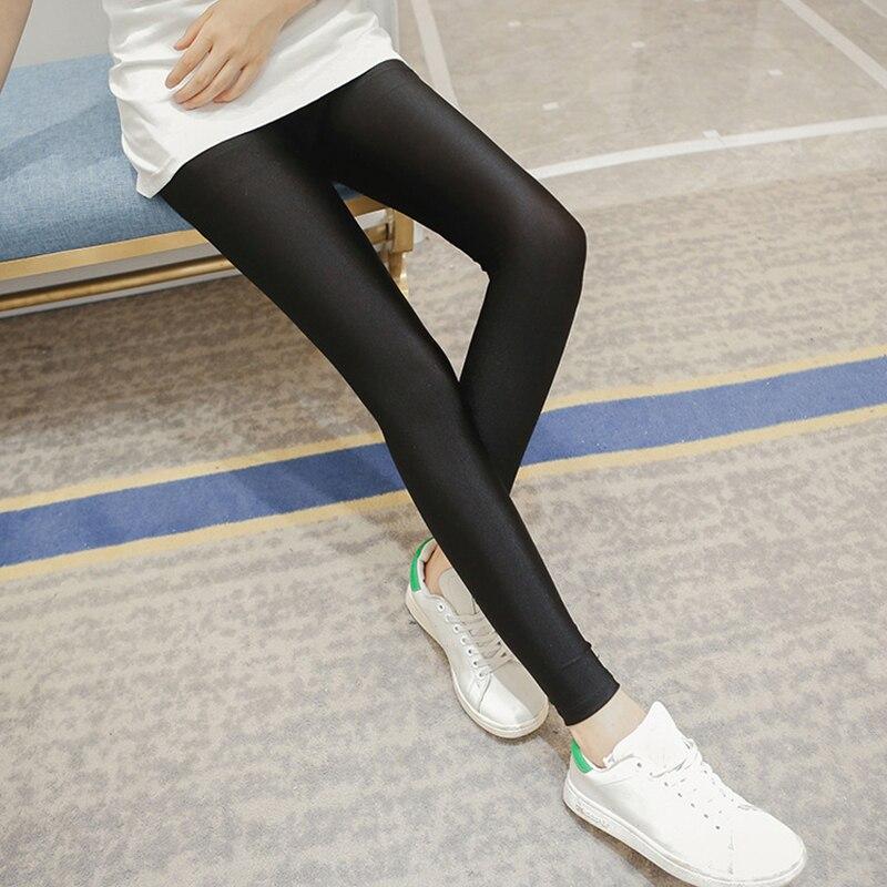 Vente chaude 2019 femmes couleur unie Fluorescent brillant pantalon Leggings grande taille Spandex élasticité pantalon décontracté pour fille goutte