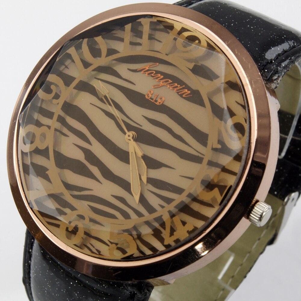 e42a4a0689b Top venta moda cebra-Raya dial cuarzo reloj señoras pu cuero banda  analógica relojes de pulsera para las mujeres caliente WH114