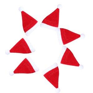 Image 4 - 10 unidades/juego de Mini sombrero de Navidad, gorro de Papá Noel, tapas de botella de vino de manzana, gorros de regalo de Navidad para decoración de árbol de Año Nuevo, ornamento para árbol