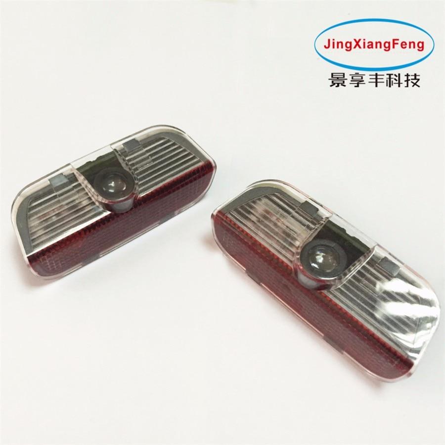JingXiangFeng 2 pcs LED Lampe De Porte De Voiture Bienvenue Ombre Laser Logo Light case Pour VW Touareg Tiguan accessoires car styling 12 v