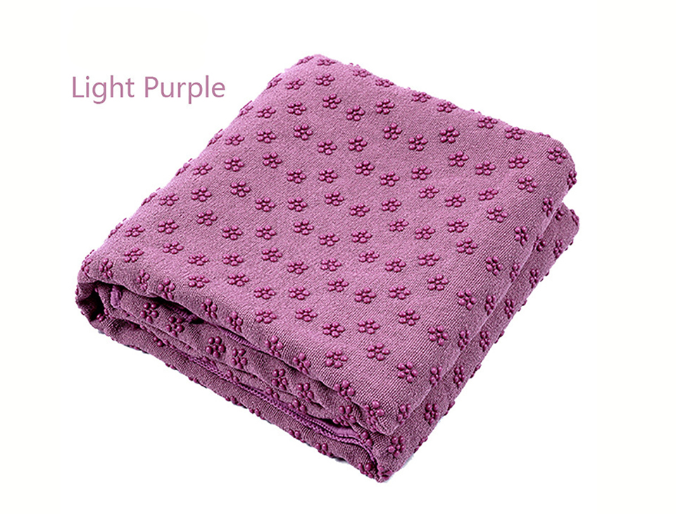 Photo of light purple color Yoga mat towel of microfiber & bag. Workout ultrafiber towel mat & mesh bag