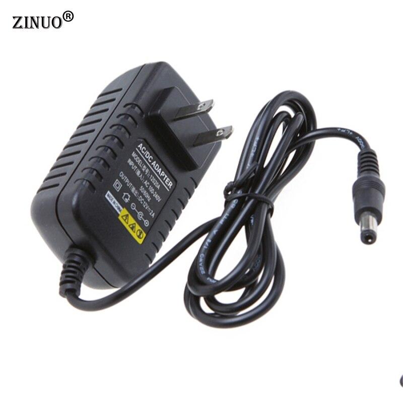 ZINUO 1Pc DC 12V 2A barošanas avots UK / US / AU / EU kontaktdakšu sienas lādētāja adaptera lādētājs Pārslēgšanas transformators LED sloksnes gaismai