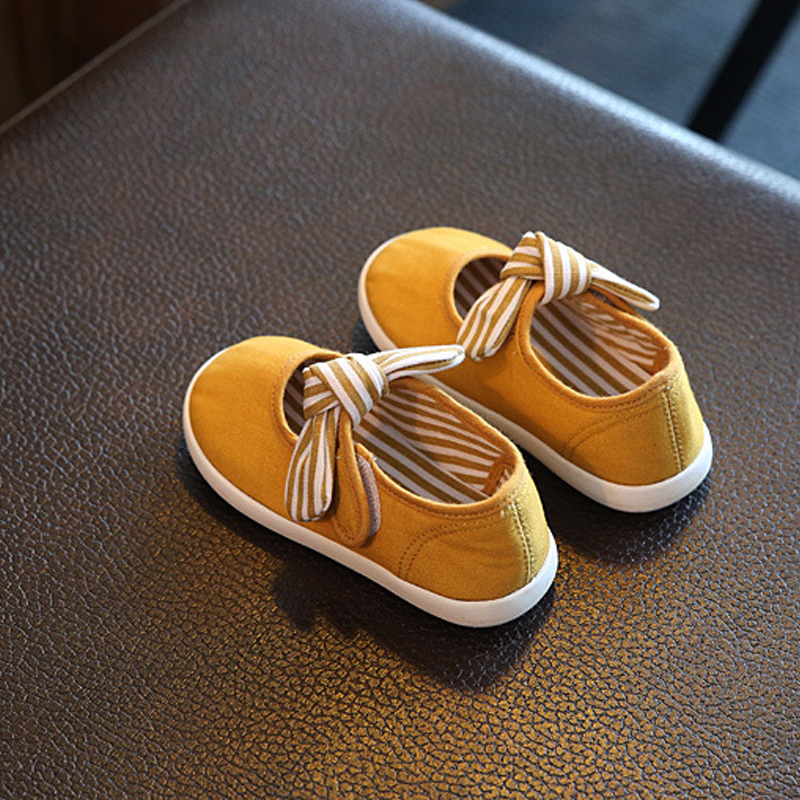 1Pair Yellow Baby First Walkers Solid Butterfly-Knot Fashion Soft Canvas Shoes Hook&Loop Lace-up Footwear Crib Shoes All Seasons classic casual baby shoes toddler newborn polka dots baby girls autumn lace up first walkers sneakers shoes