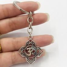 XKXLHJ 1Pcs Filigree Cute keychain OHM OM AUM Buddha Lotus Silver Keychain Pendant , Buddhist, Yoga Keychain цена в Москве и Питере