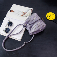 2017 heiße neue mode frauen koreanische quaste niet eimer tasche weiblichen kordelzug orange ring mini schultertasche messenger bag