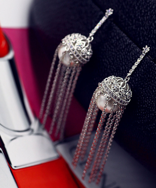 Высокое качество женщины Кисточкой Серьги длинные серьги уха пряжки моды личности темперамент Корейских ювелирных