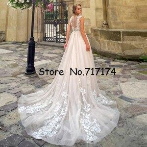 Image 2 - O neck tulle 민소매 레이스 아플리케 a 라인 웨딩 드레스 (벨트 포함) illusion button back court train castle bridal dress