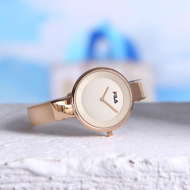 bfb8aabf01e Fila de reloj de las mujeres reloj de cuarzo para las mujeres dama Simple  correa de cuero resistente al agua Venta de moda y Casual 781 en Relojes de  amor ...