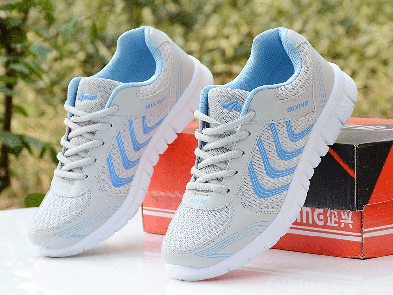 Foto from the front 2 piece Women's breathable light sneakers for tennis. Women's breathable light shoes for basketball white color with white with blue