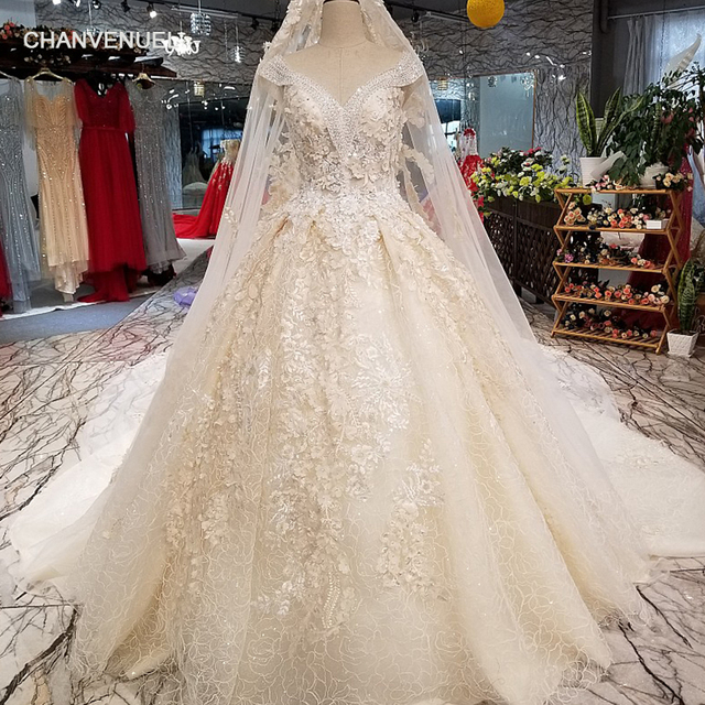 c087e893ea182 Aliexpress.com : Buy LS07741 luxury free shipping wedding dress beading v  neck cap sleeve sexy bride gown high quality dresses with golden lace veil  ...