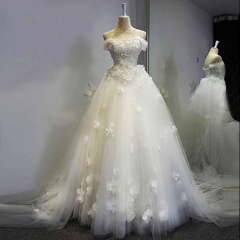 Robes de bal de mariée sans bretelles blanches de luxe robes de soirée de Mariage sans manches Appliques de dentelle Robe de départ Robe Mariage