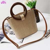 TZY 2018 New Trend Straw Bag Package Women Beach Vacation Handbag Round Wood Handle Summer Beach Shoulder Bag Lady Wicker bag