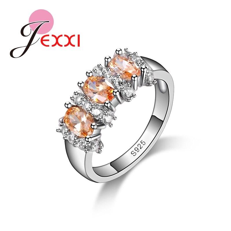 b92c7810bf43 JEXXI nueva llegada 925 plata esterlina anillos de moda para las mujeres  chicas accesorios de boda con Shinny champán CZ Crystal