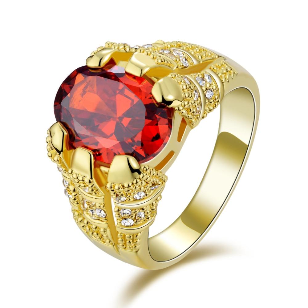 bague or avec pierre rouge