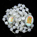 6 mm white resin cat's eye bead rosary with Our Lady of Guadalupe pendant and center medal