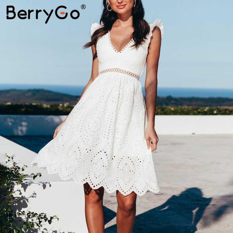 Berrygo dos nu col en v à volants blanc femmes robe été 2019 broderie coton robe courte élégante sans manches robe de soirée femme