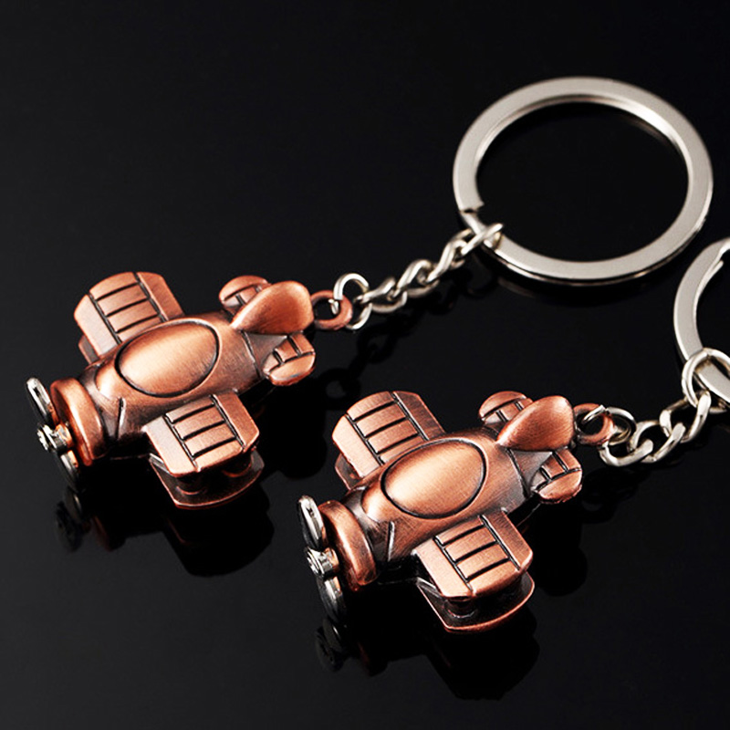 The propeller biplane Keychain World war ii biplane Airplane pendant model airplane Key Chain Keyring German Japan old aircraft image