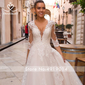 Image 4 - Sexy V hals Applicaties Wedding Dress Swanskirt Half Sleeve Lace Up A lijn Hof Trein Prinses Bruidsjurk Robe De Mariage LZ10