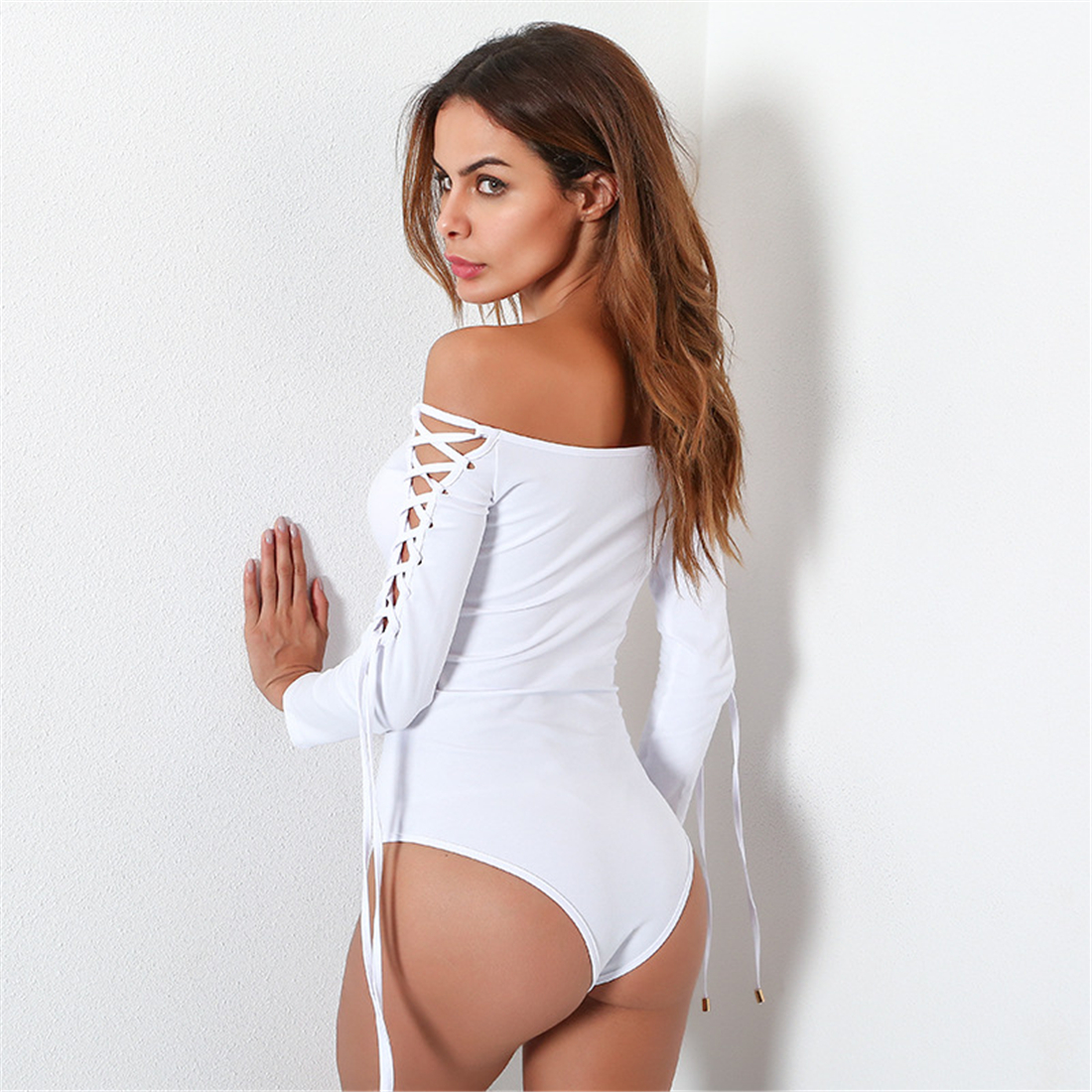 YJSFG HOUSE Solid Black White Slash Neck Hollow Out Bodysuit Women Long Sleeve Lace Up Jumpsuit Rompers Sexy One Piece Catsuit