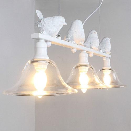 The new Northern European pendant light coffee shop warm modern simple bar glass pendant lamp American pastoral village lights
