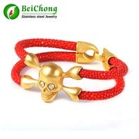 (10 unids/lote) Rojo Stingray Stingray Pulsera Mujeres del Cuero Genuino Pulsera de Oro Pulsera Del Cráneo Del Acero Inoxidable para Wome