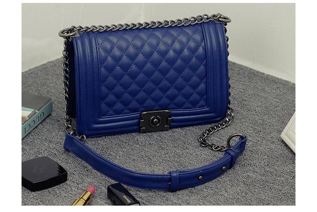 Fashion black PU leather shoulder women bag 2017 Rock style flap shoulder bag for sale