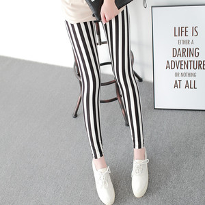 Image 2 - Black and White Vertical Striped Printed Women Leggings Fashion Casual Elasticity Ankle Length Pant Female Fitnes Legging