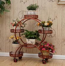 The multi-layer belt wheel iron art flower shelf European assembly corner living room mobile shelving
