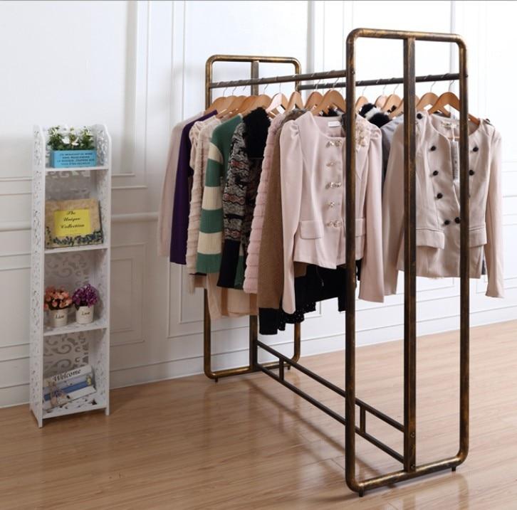 Wrought iron clothing rack shelf clothing store window
