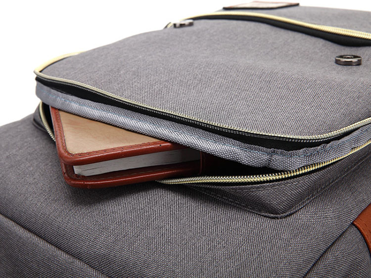 an agende inside a grey backpack