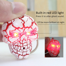 Funky LED Light and sound skull key chain