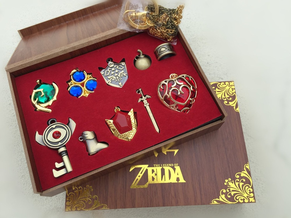 FREE SHIPPING New The Legend of Zelda Triforce Hylian Shield & Master Sword Keychain/necklace/Weapons 10pcs Set Collection