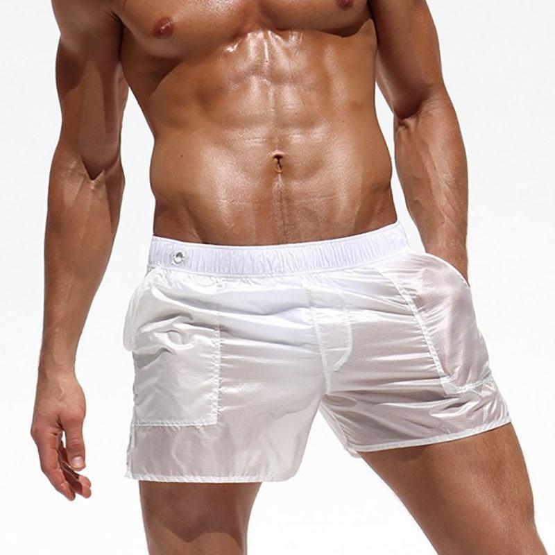 Pantaloni della Spiaggia degli uomini Sexy Traslucido Shorts Pantaloni Della Tuta Costumi Da Bagno Swim Shorts Tronchi di Nuoto Surf Beach Breve Sport Homme Costume Da Bagno