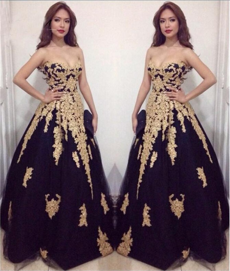 Black and gold ball gowns