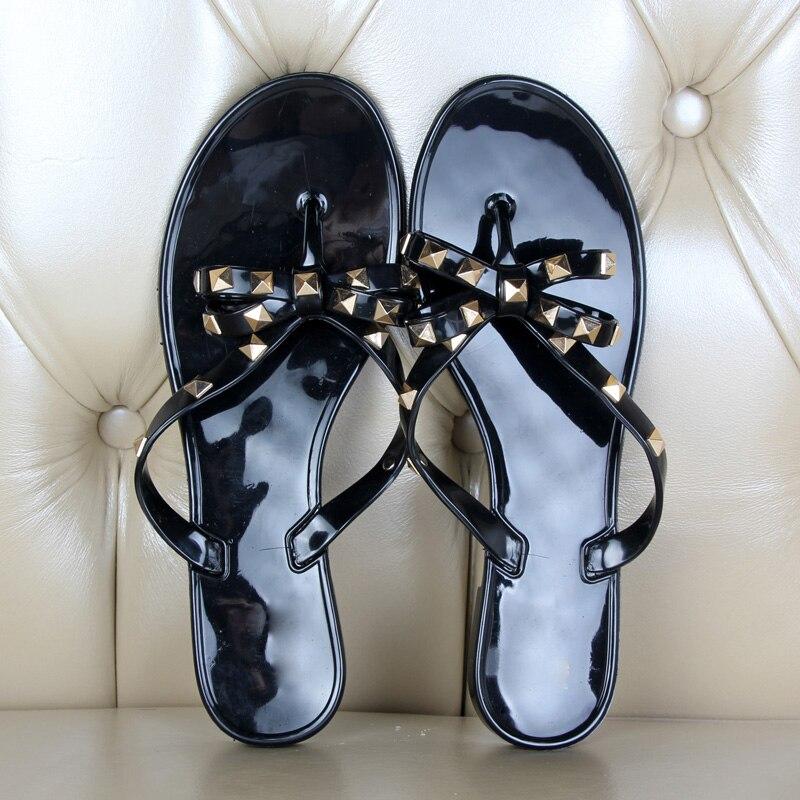 HTB1G 26rDJYBeNjy1zeq6yhzVXa7 Hot 2017 Fashion Woman Flip Flops Summer Shoes Cool Beach Rivets big bow flat sandals Brand jelly shoes sandals girls size 36-40