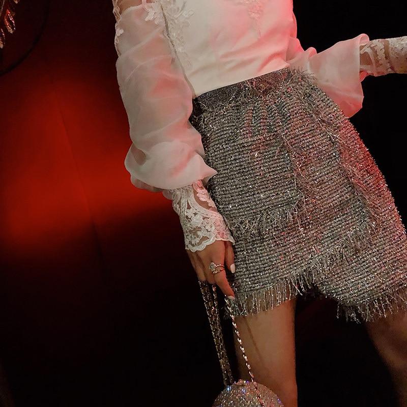 2019 Lolita jupes femmes Polyester solide naturel jupes Midi jupe nouveau femmes lumineux asymétrique gland fendu fourche hanche femmes