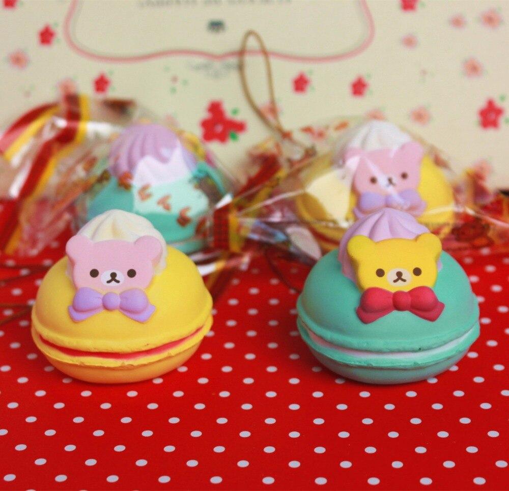 imágenes para Comercio al por mayor 10 unids/lote 5 cm kawaii squishy Rilakkuma original Macaron cake queeze juguetes bolsos del teléfono celular correas squishies pan