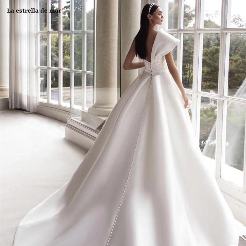 Suknie slubne2019 new one shoulder satin bow black ivory wedding gown trailing abito da sposa custom casamento in Wedding Dresses from Weddings Events