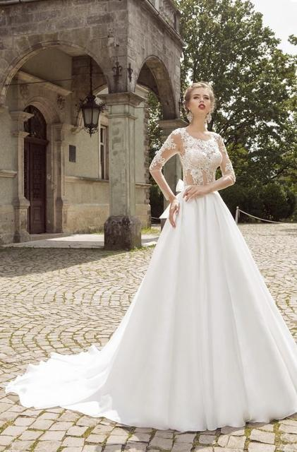 Long-Sleeved Wedding Dresses with Corset Bodess